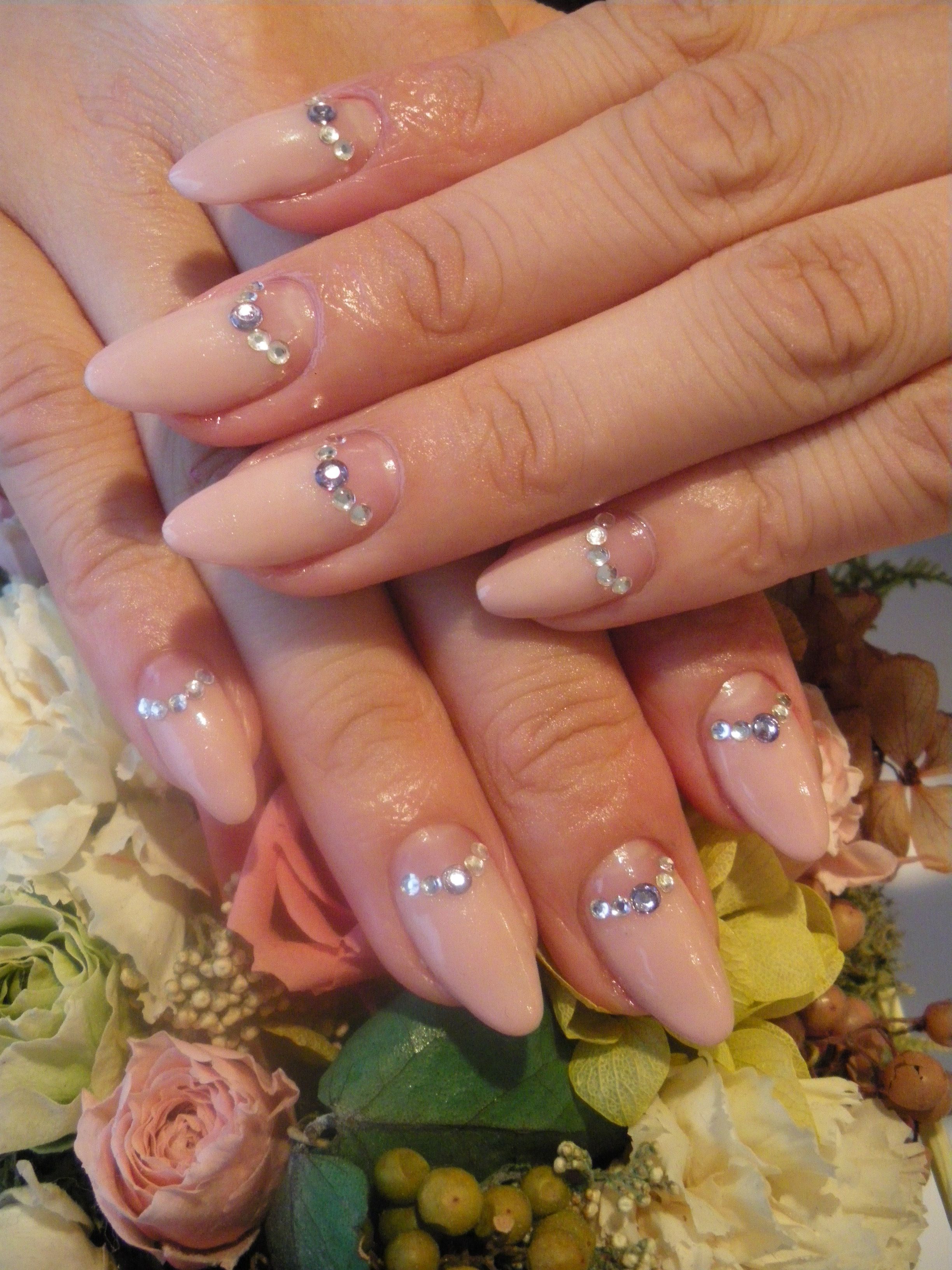 Almond half moon neutral beige nails with Swarovski crystals from ...