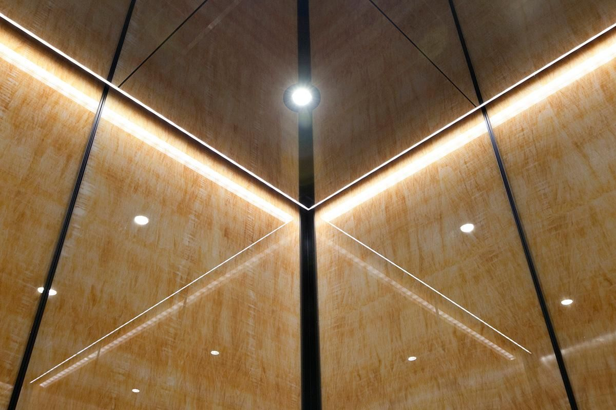 Elevator ceiling in fused nickel silver with mirror finish led elevator ceiling in fused nickel silver with mirror finish led downlights and led perimeter accent lighting elevator interior with upper panels in dailygadgetfo Image collections