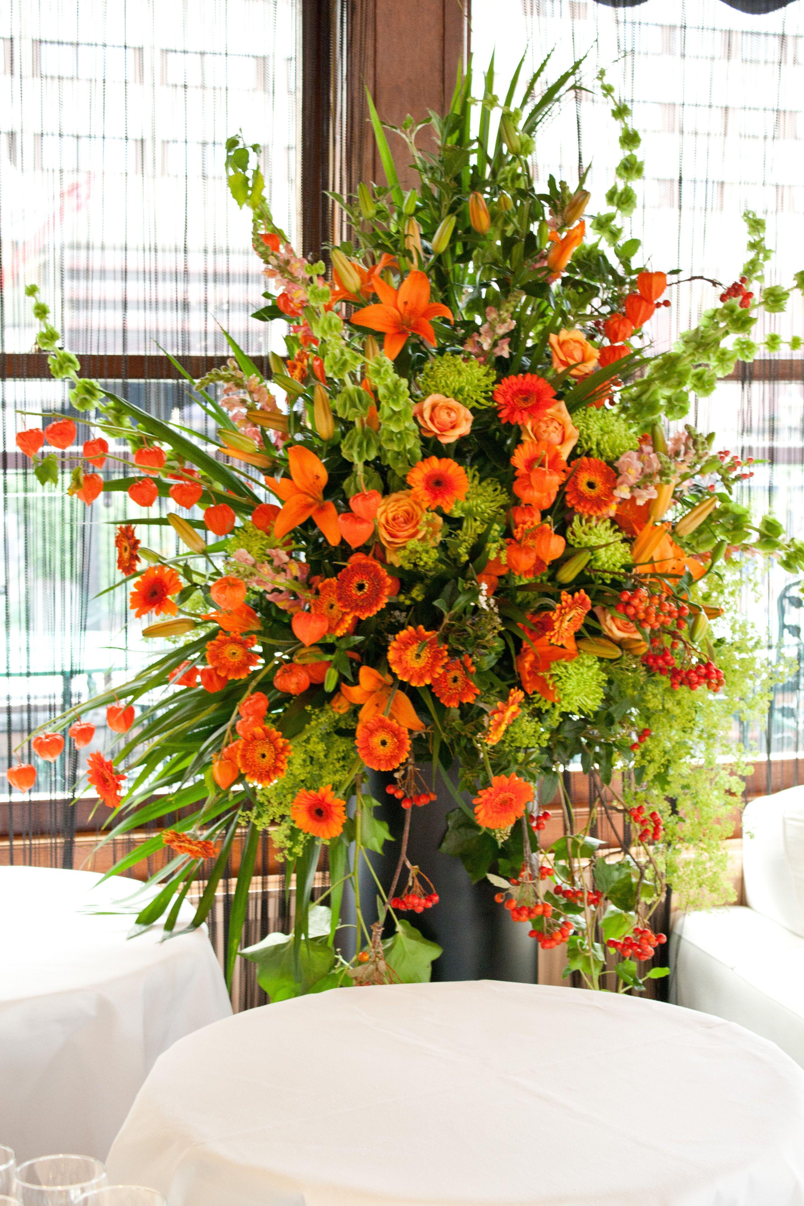 Orange And Lime Green Flower Pedestal Arrangement