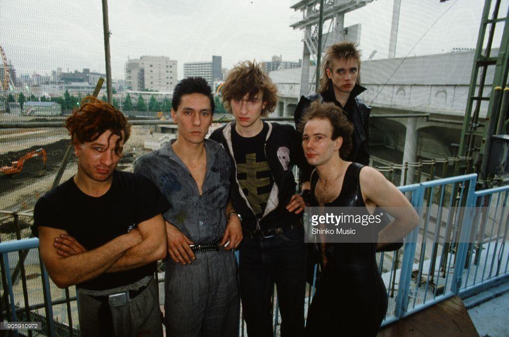 Einsturzende Neubauten taken at a construction site, May 1985, Tokyo, Japan. Blixa Bargeld, Mark Chun, F.M.Einheit, N.U.Unruh, Alexander Hacke.