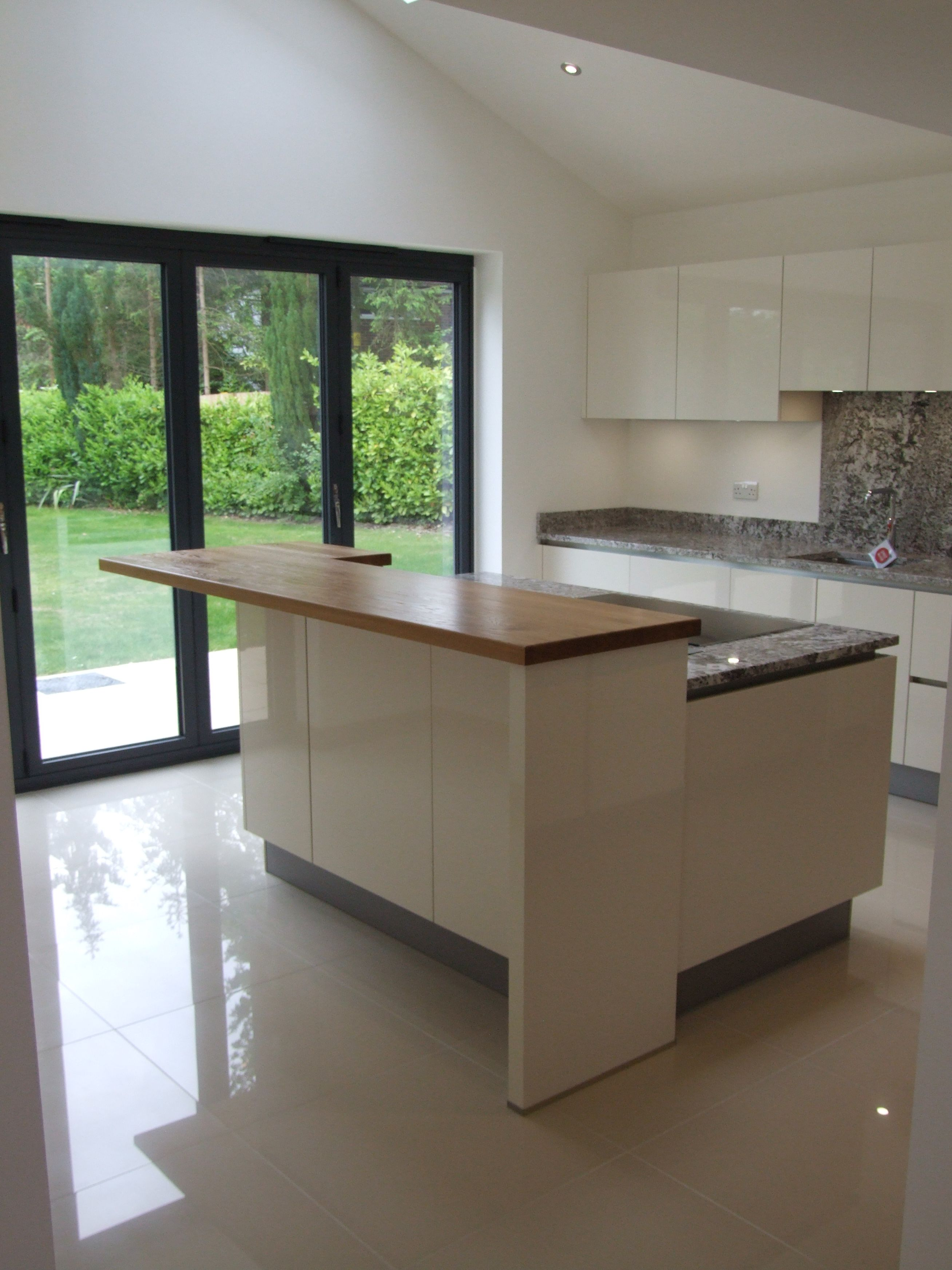 this enticingly light and airy kitchen consists of high gloss