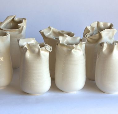 Frances Palmer's handmade pots are deliberately asymmetrical, with quirky misaligned fluting that dramatically expresses the hand of the artist.