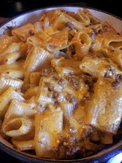 Taco Pasta Bake  •1/2 - 3/4 of a bag of large noodle pasta like ziti    •approx. 1lb of ground beef   •1 pkg/envelope of taco seasoning   •1C water   •1/2 pkg of cream cheese (about 4oz)   •1 1/2C shredded cheese   Cook pasta, drain.  Cook beef and add taco seasoning and water.  Mix with pasta and 1 c cheese, sprinkle remaining 1/2 c cheese on top.  Bake at 350 for 30 min