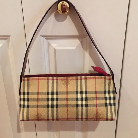 ad4afa6ef1b7 Burberry smaller purse Classic check pattern with red leather handle ...