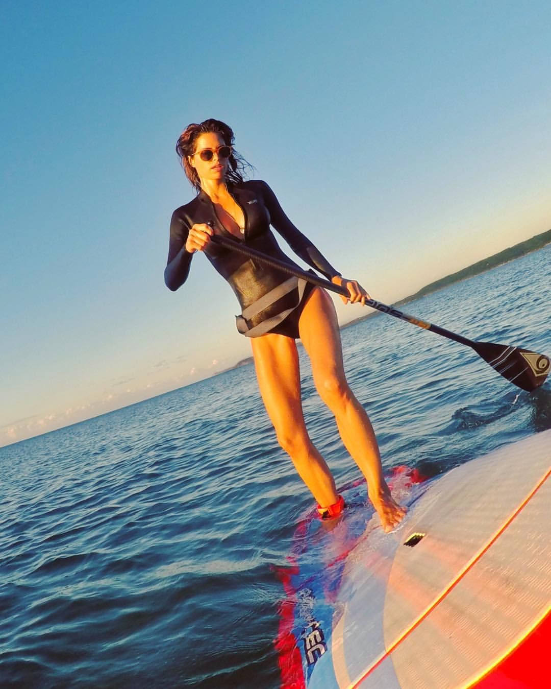 Making A Turn On A Stand Up Paddle Board Standup Paddle Paddle Boarding Paddle Surfing