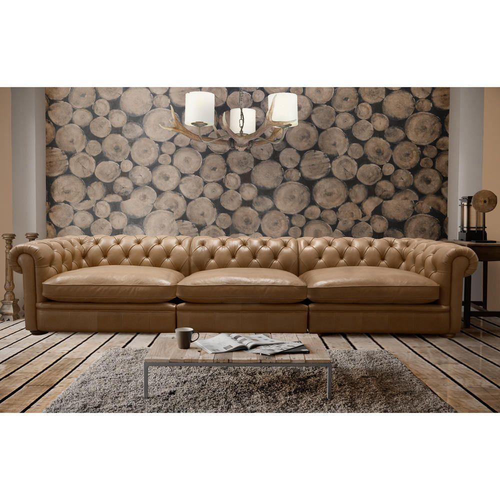 This Captivating Sofa Features Deep On Tufting Along The
