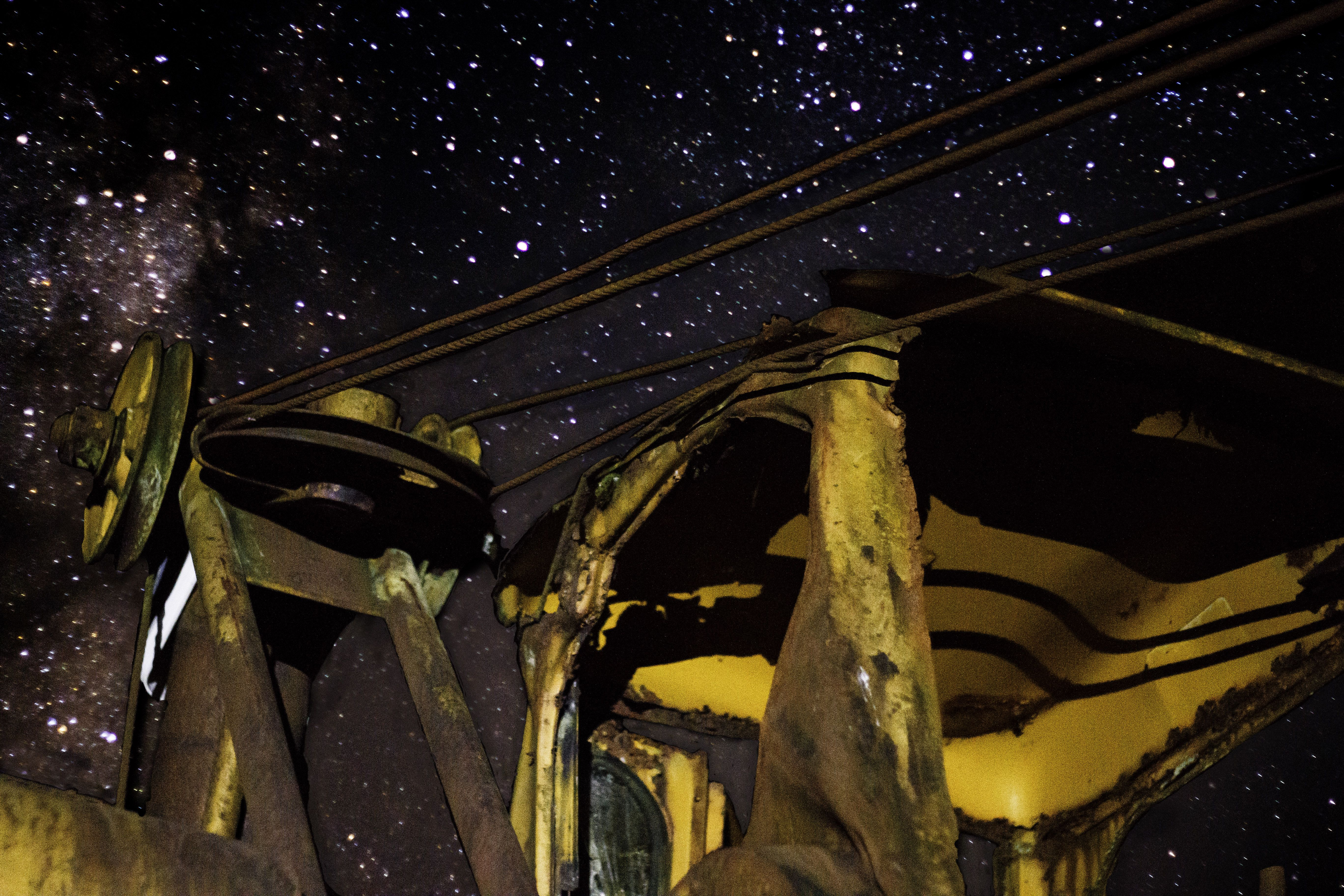Old Beat Up Farm Equipment In Front Of A Starry Sky By Bonnie