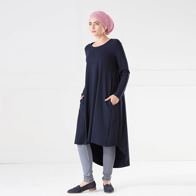 Elena is perfect for layering and staying warm this winter. With long sleeves and a round neckline, both the length and fit of this dress are super-flattering. The cut is classic, but with a stylish twist, there are two deep pockets and a high low hem.  Shop Now: http://www.myanaya.com/shop/elena-midi-dress-in-navy  #anaya #modestwear #hijabstyle