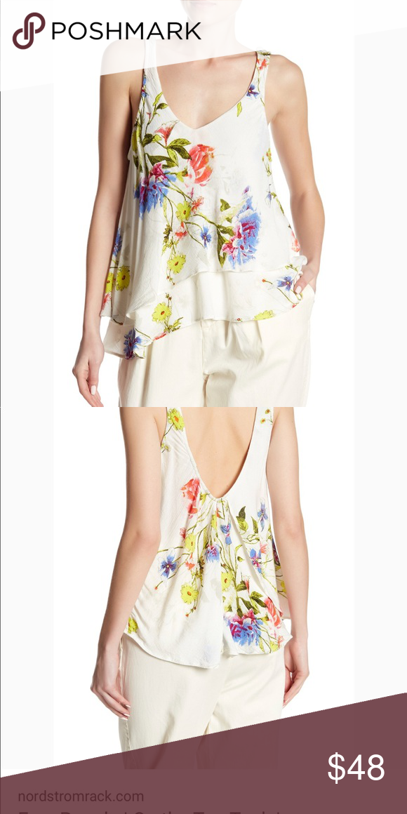 56b4fb02833b0 Free People on the top tank top An asymmetrical tier flutters down the side  and adds playful movement to this lightweight floral tank.