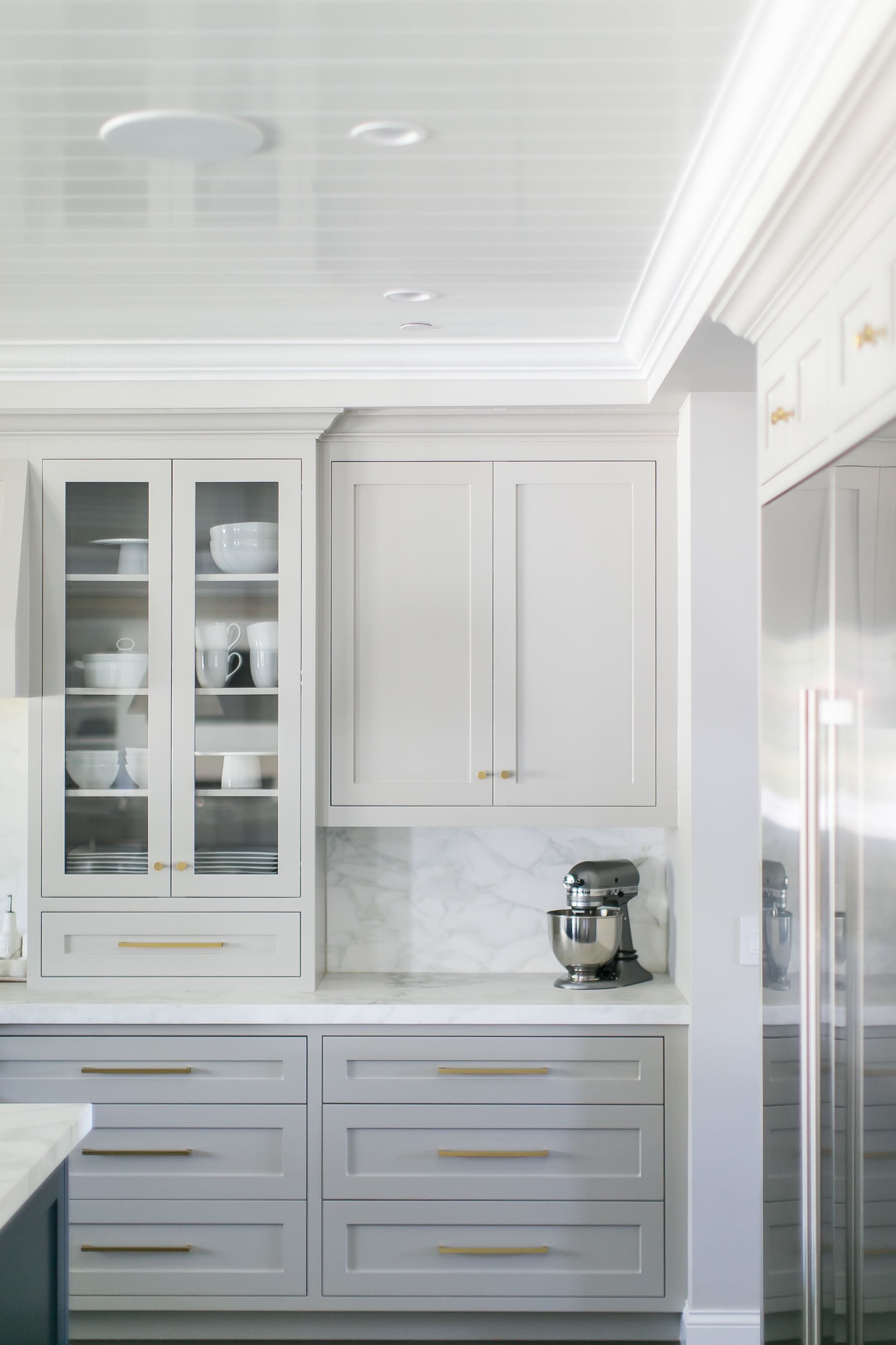 Gorgeous light grey cabinets, marbled countertops & backsplash ...