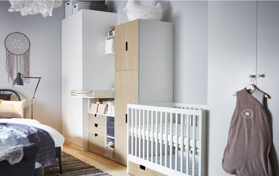 This nursery idea places a crib, changing table and babies storage ...