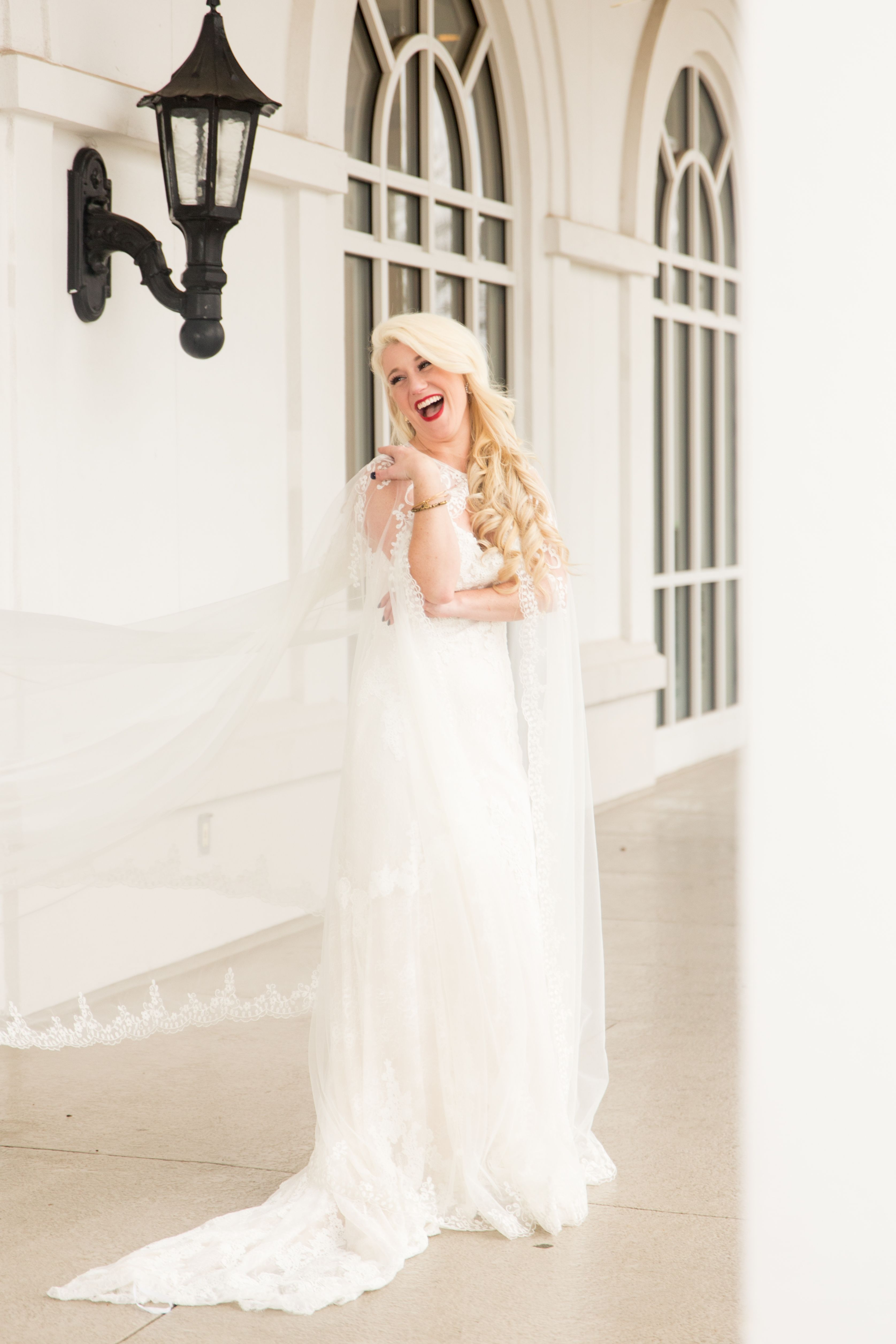 ashley's platinum blonde, hollywood wedding hair is almost