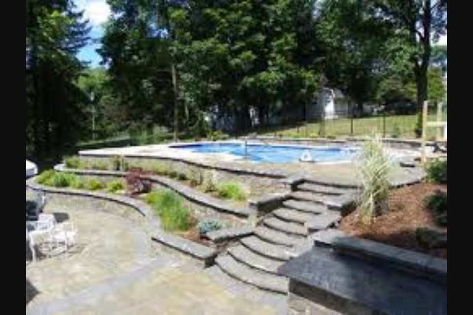 Inground pool on slope bc apparently we need a retaining for Pool design sloped yard