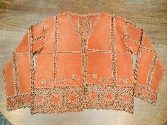 This is an absolutely fabulous rust color boho jacket from the 1970s style. It has more detail than any other jacket Ive seen like this,