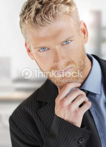 Fashionable Young Handsome Business Man With Nice Blue Eyes In