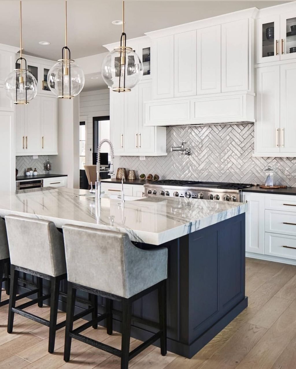 Amazing kitchen with white cabinets with navy blue island ...