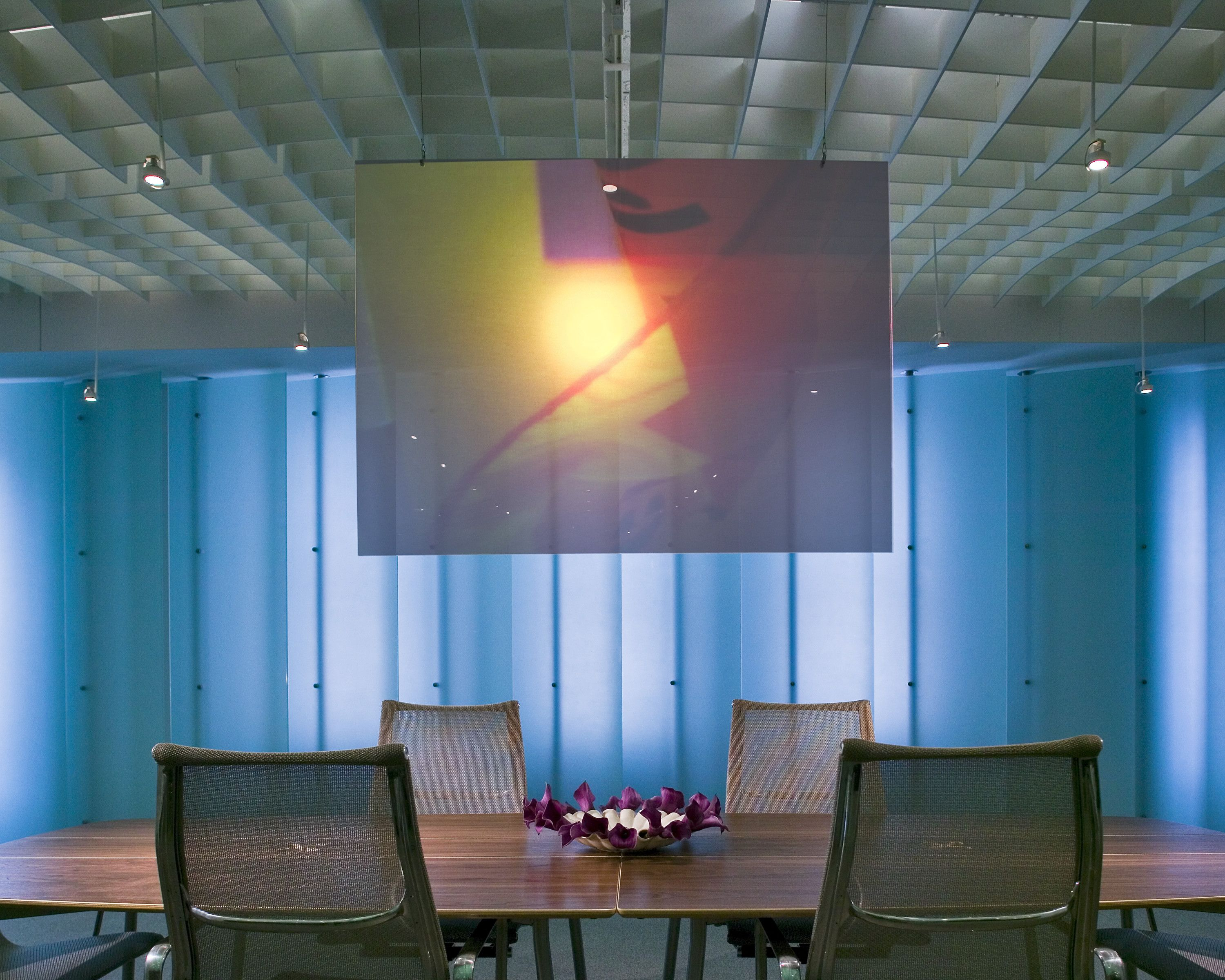 Conference area with eames aluminum group chairs sin duda