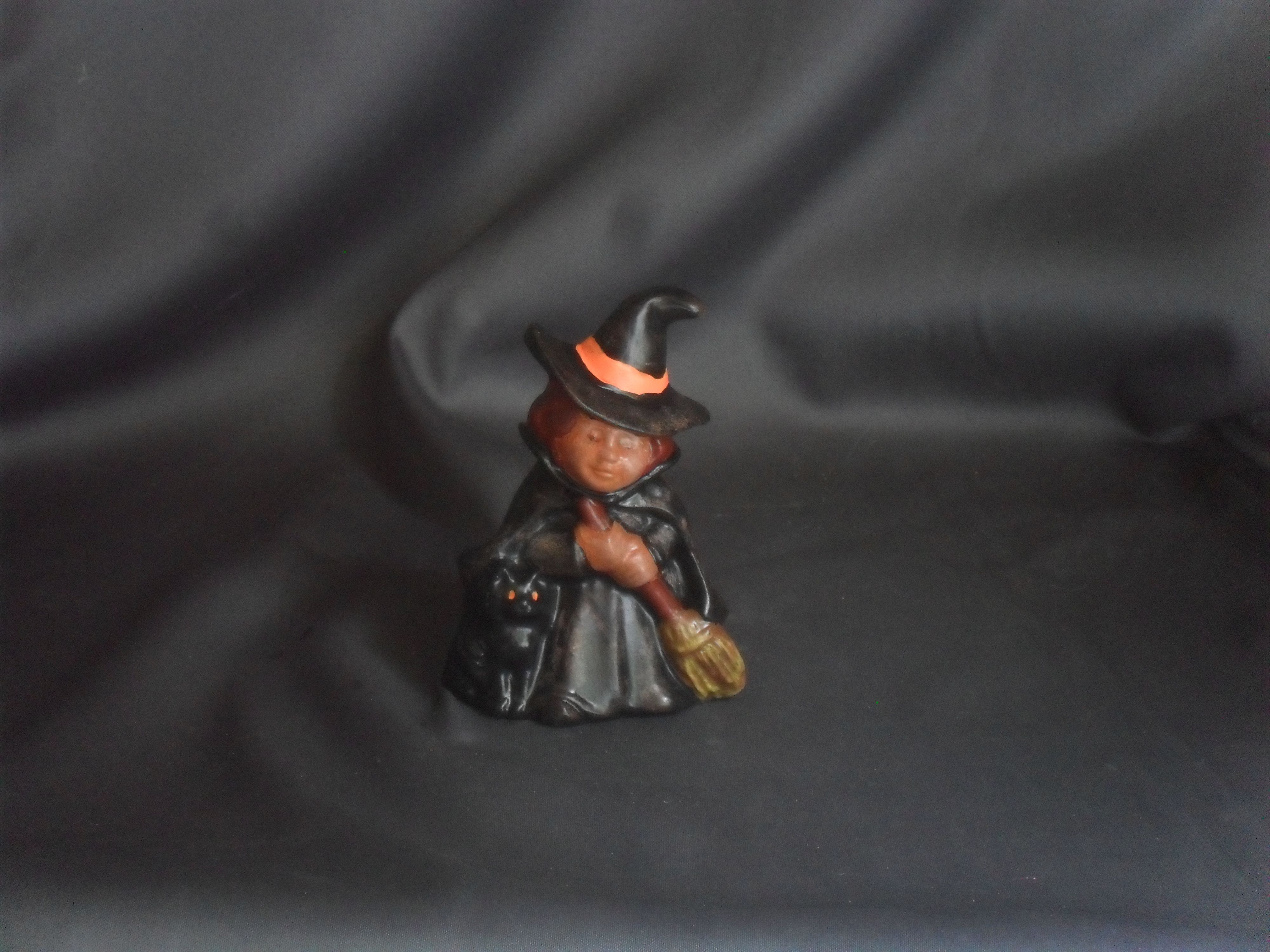 "This cute little witch is made using a vintage mold made by Duncan ceramics in 1973 and was hand painted making it a one of a kind original.   The little witch figure is 4 ½"" tall x 2 ¼"" wide x 2 ¼ "" in depth . She is dry brushed to highlight her ..."