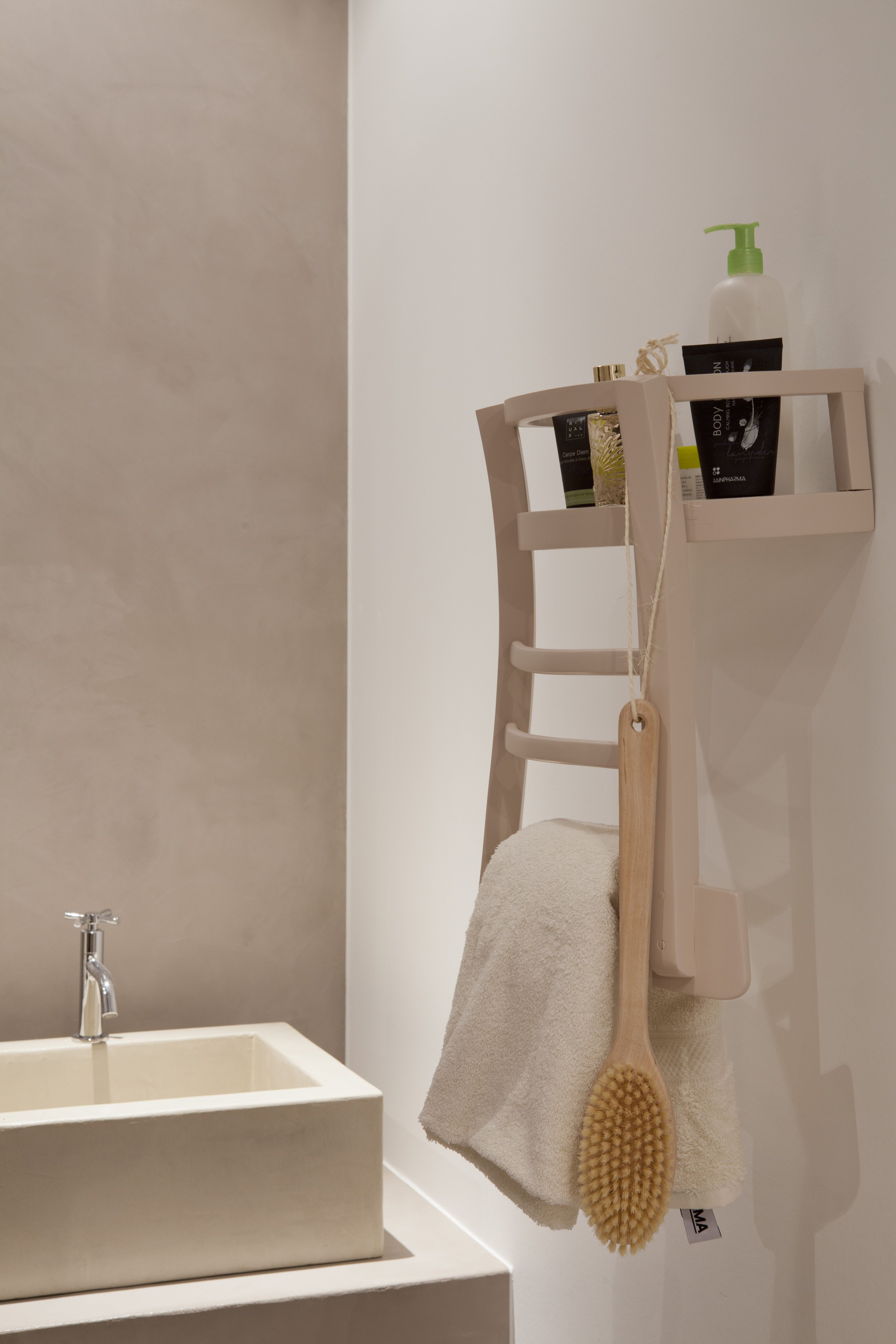 Upcycled old chair used as a towel rack! Conveniently ...