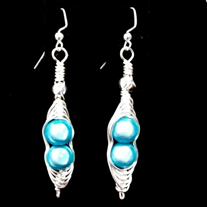 Hand-crafted with aqua (turquoise) Miracle Beads, silver accent beads, then individually hand-wrapped in non-tarnish silver Artistic Wire. These beads seems almost unreal! As you look at them they almost seem translucent & glissing!