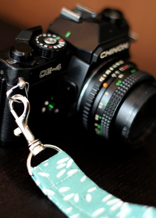 This is a camera wristlet, but I don't see why a full strap couldn't be done the same way.