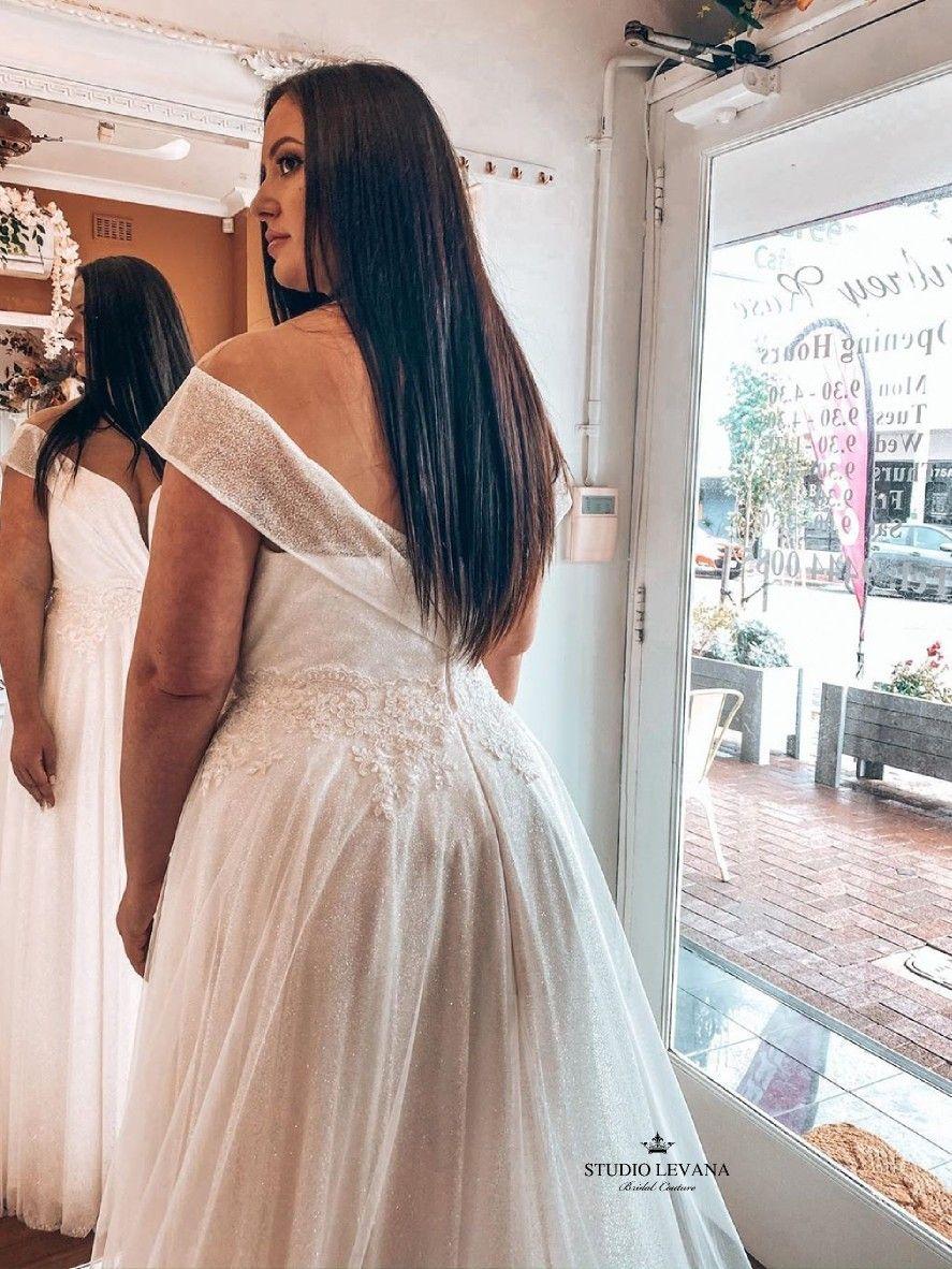 Plus Size Sparkly Saar Wedding Dress With Off Shoulder Straps By Studio Levana Modest Wedding Gowns Wedding Dresses Plus Size Wedding Gowns [ 1182 x 887 Pixel ]