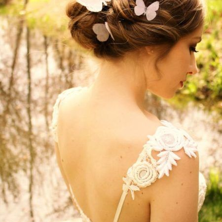 Butterfly wedding ideas for the bridal look. Add some silk organza butterfly hairpins.