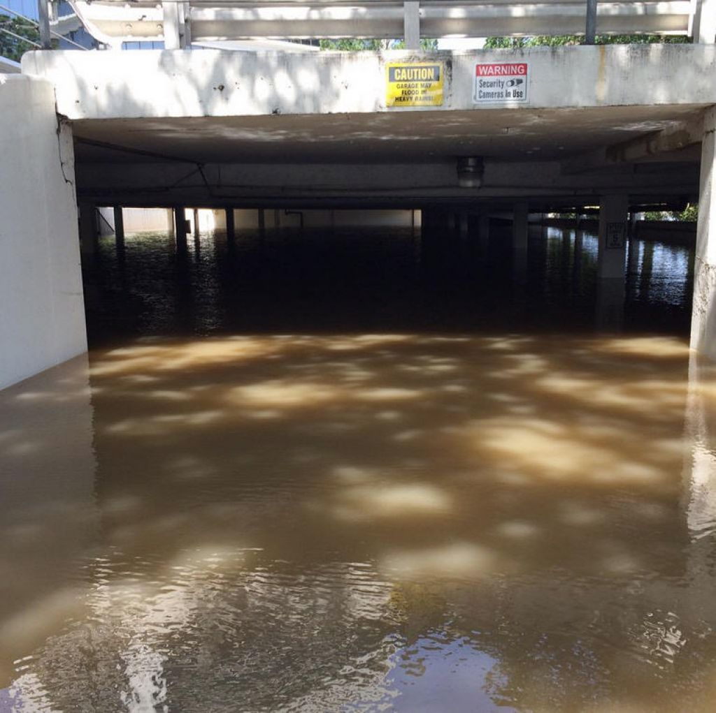 Flood waters covered many of Houston's major roadways on Tuesday, May 26, 2015. This parking garage near Buffalo Bayou has been filled with almost 7 feed of water. Photo: St. John Barned-Smith