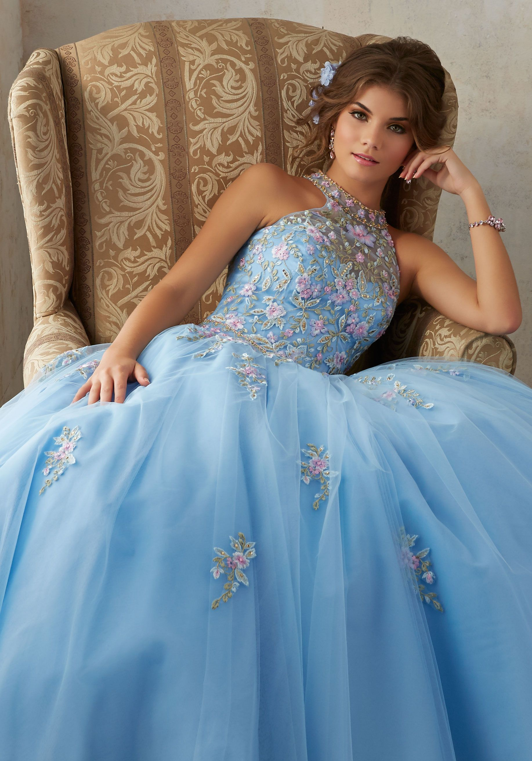 Floral embroidey takes center stage on this tulle quinceañera dress