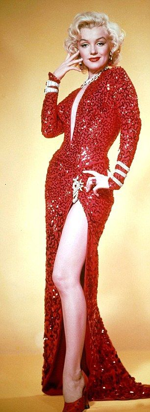 Marilyn in that famous red dress from the opening scene of Gentlemen Prefer Blondes, designed by William Travilla.