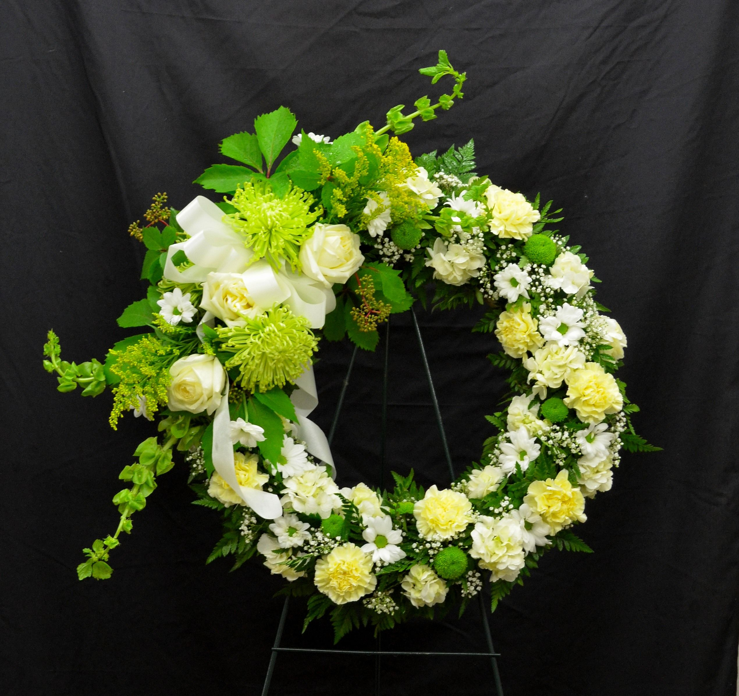 Wreath with a spray for a man flowers pinterest wreaths wreath with a spray for a man funeral flower arrangements vase arrangements funeral izmirmasajfo