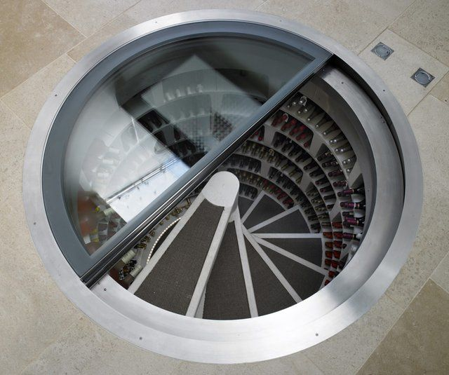in-ground wine storage that you can see down into from your floor
