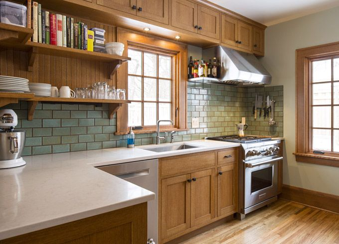 Beautiful craftsman bungalow kitchen combines modern and natural elements. Gorgeous built-ins and handmade tiles.
