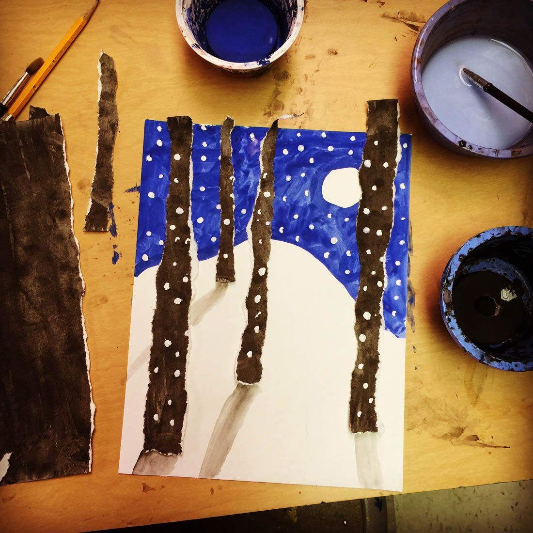 Torn painted paper looks an awful lot like real trees. #artprojectsforkids #winterlandscape