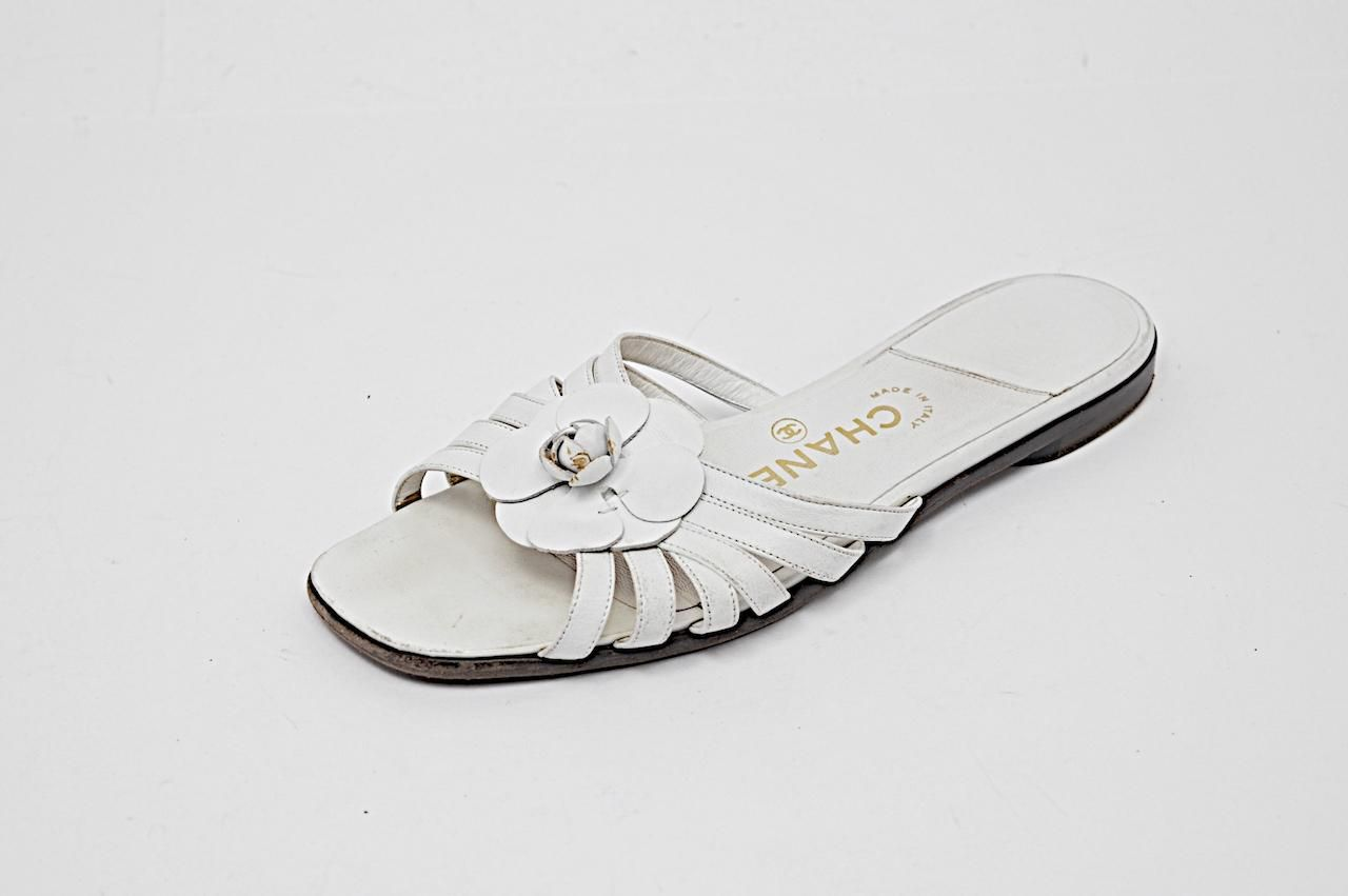 4cf9ea83e4 Chanel Leather Strappy Flat With Flower White Sandals. Get the must-have  sandals of this season! These Chanel Leather Strappy Flat With Flower White  Sandals ...