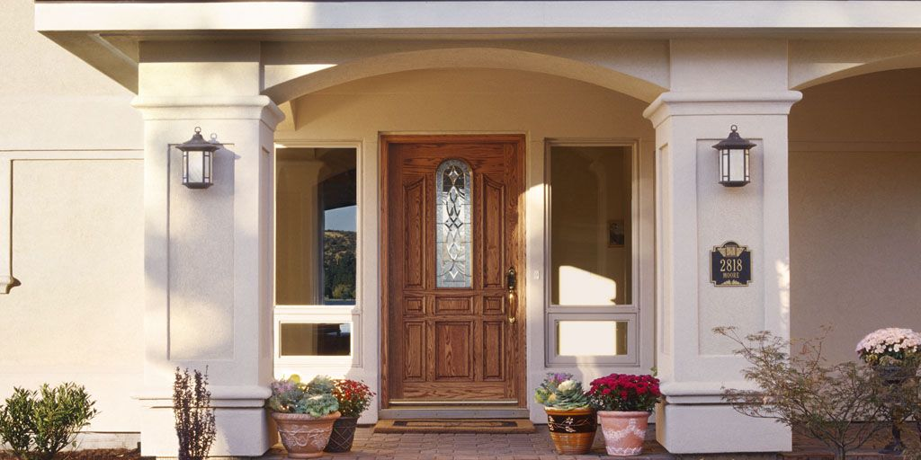 A well-placed pane of glass in your front door can increase natural light year round while adding a decorative touch.