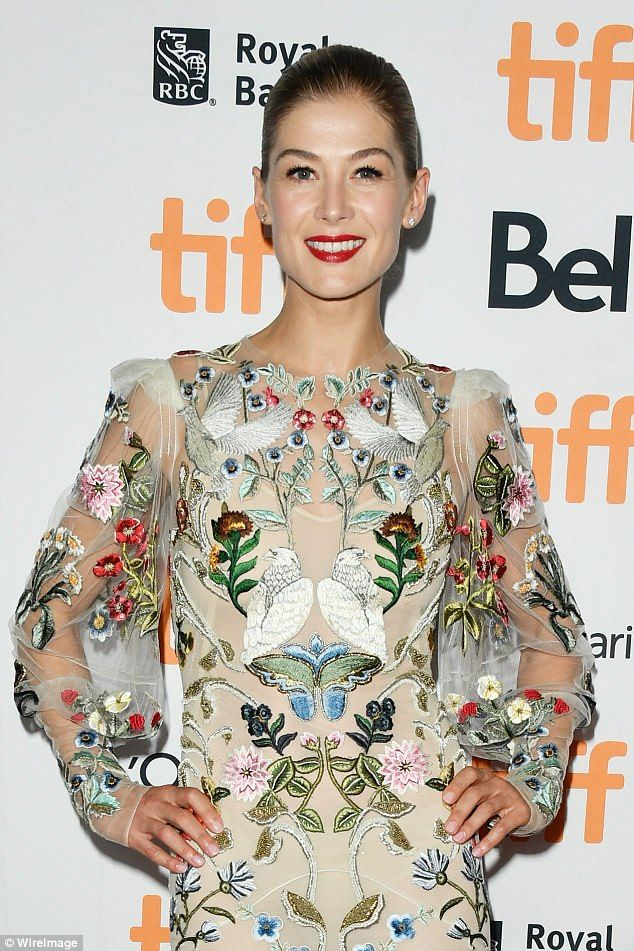 Rosamund Pike dazzles on red carpet in Toronto in floral