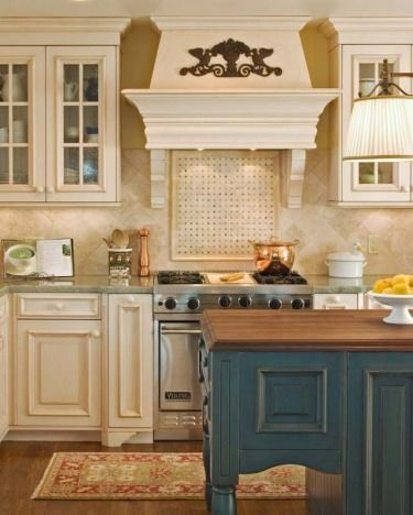 #alder #and #Aquamarine #cabinetry #finishes #hood. #In