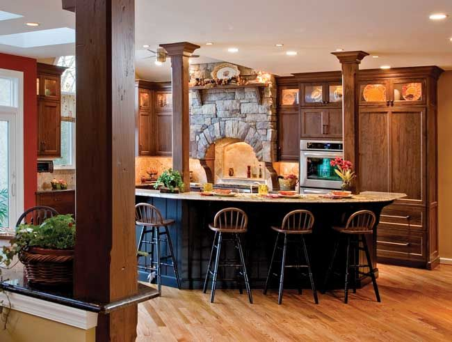 black cabinetry on the kitchen island contrasts with the medium brown wood of the wall and base on kitchen island ideas black id=64910