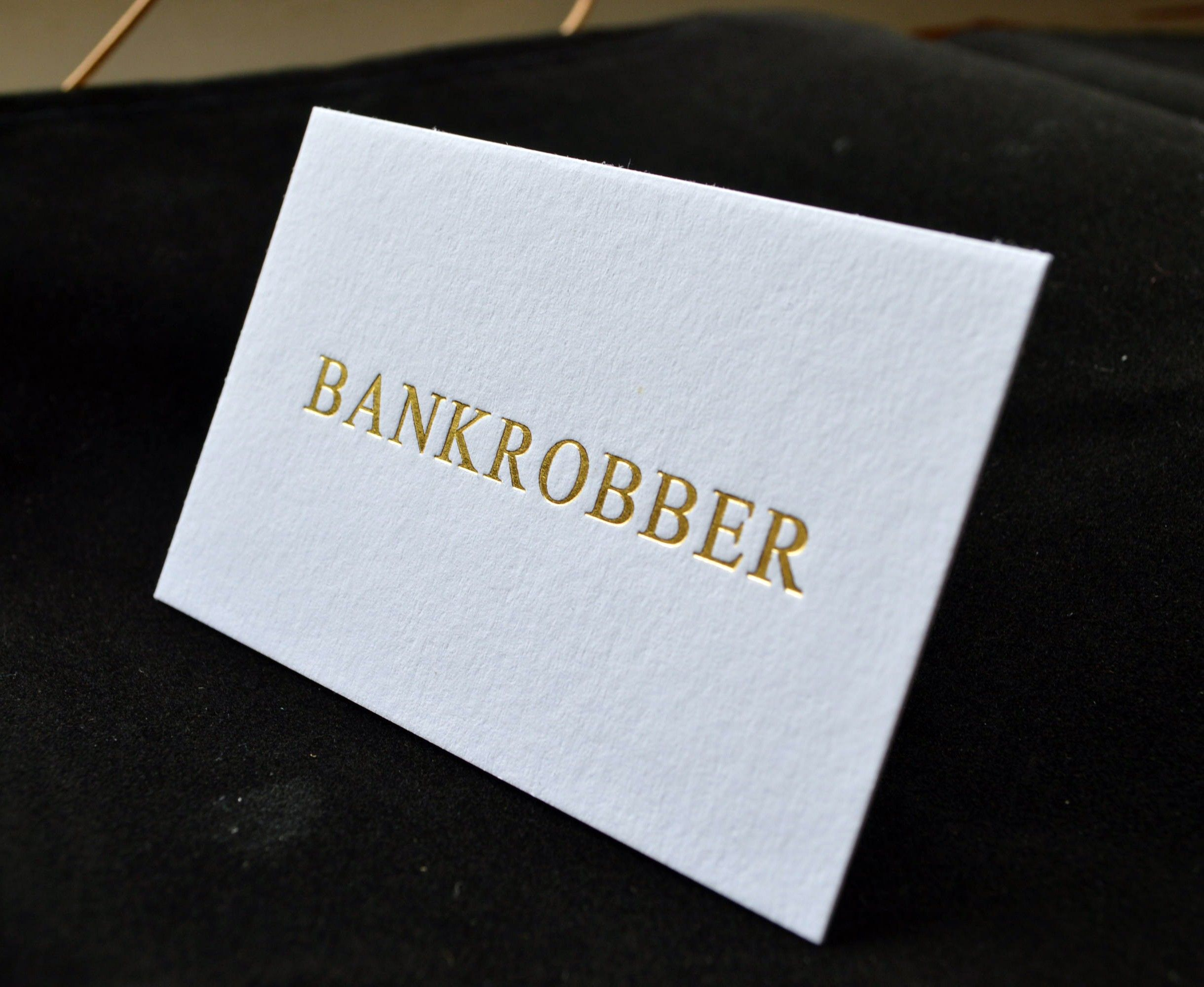 A beautiful gold foil debossed card on a thick 540gsm