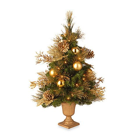 Heralding the holidays, this mixed needle Elegance entrance tree instantly adds elegance to your front porch or foyer. Exquisitely detailed with gold accented branch sprig, pine cones and shimmering ball ornaments.