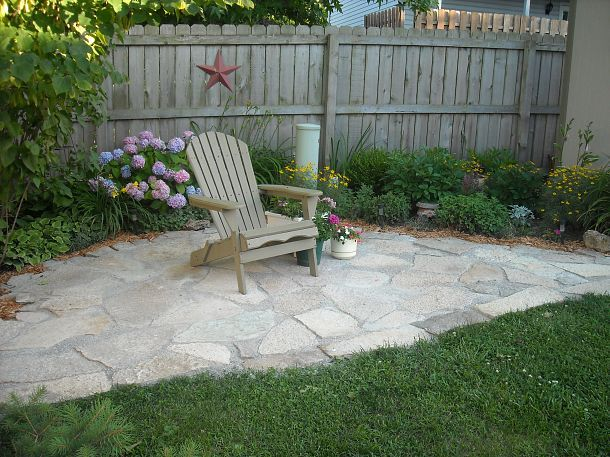maybe flagstone instead of concrete to extend the patio?