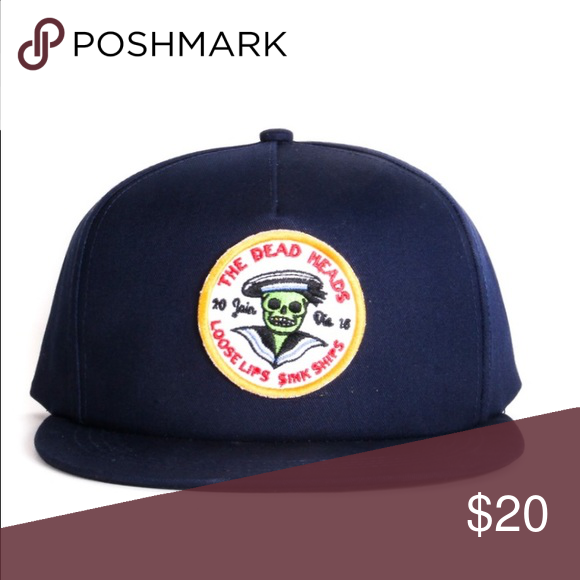 The Dead Heads Tracker Cap 'loose lips' - 100% Twill Cotton  - Mesh Trucker cap.  - Embroidered front patch  - Rope detail  - Woven snap label  - Woven inside label  - Swing tag Accessories Hats