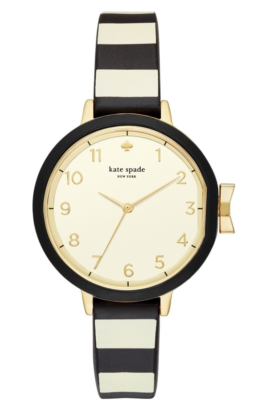 abba62b9d85 Bold stripes enhance this mid-size Kate Spade watch controlled by a  signature bow-