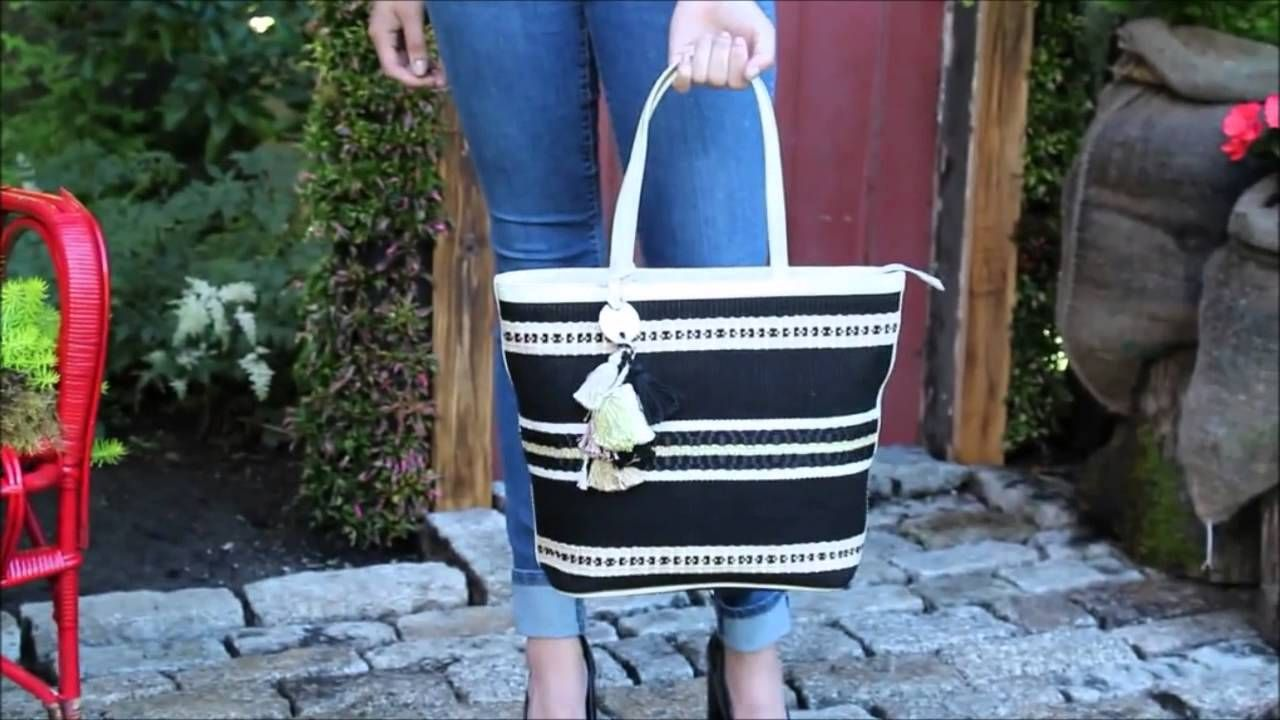 Our beautiful Rebecca Eclipse bag is trimmed with beige patent leather. Made from Pima and Tangüis cotton with satin threads. The main color of this bag is black so it is versatile enough to go with any color you're wearing. The fun cotton and metal accents reflect the Inca style. The interior is fully lined and has pockets; the bag closes with a zipper.  Price $284.75