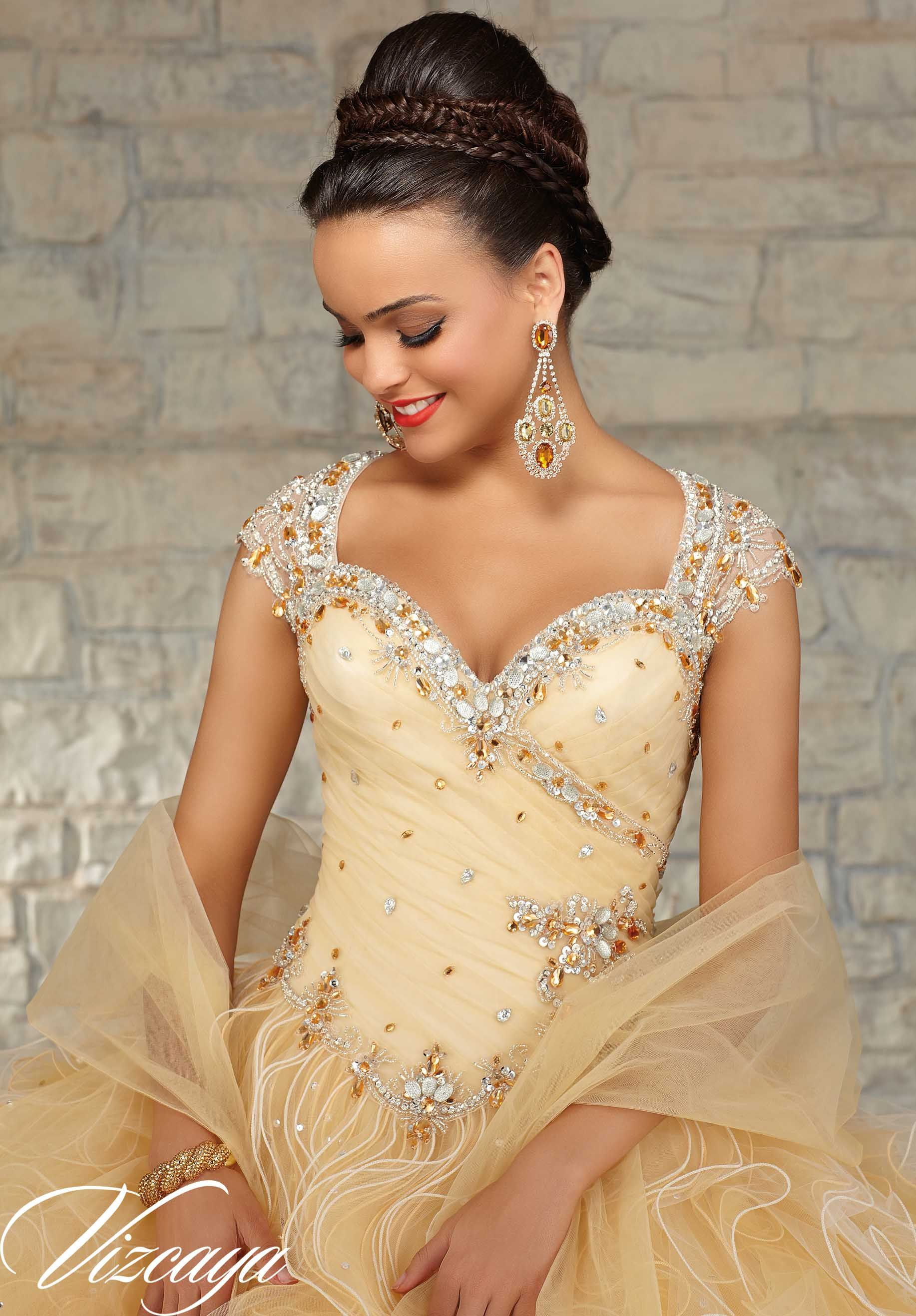 b52633c38a0 89033 Quinceanera Gowns Beaded Tulle with a Ruffled Ball Gown Skirt. Cream