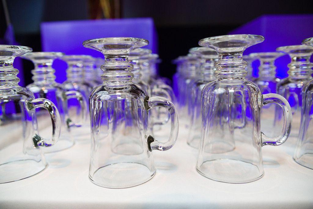 Dead Sea Scrolls VIP event 2013 - Irish Coffee mugs all lined up on LED bars #TheLeonardo #deadseascrolls #coffee #LEDbar #LeCroissantCatering