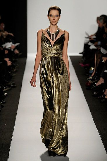 The gold lame fabric is so delicately draped. Molten Metal  Evening Gown ... b9ba887ec1