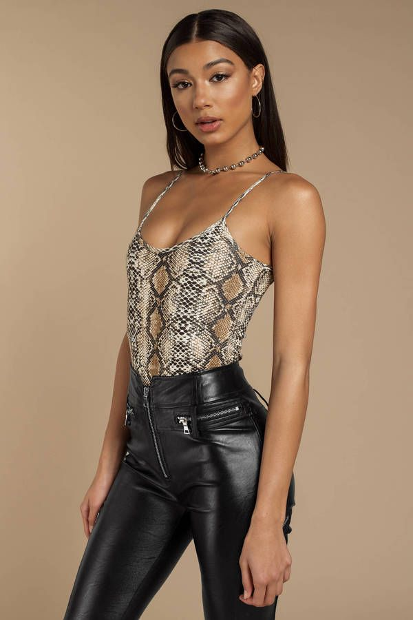 Be sexy and dangerous in the Poisonous Tan Snake Print Bodysuit. This animal  print bodysuit features thin spaghetti straps 54b620dd4