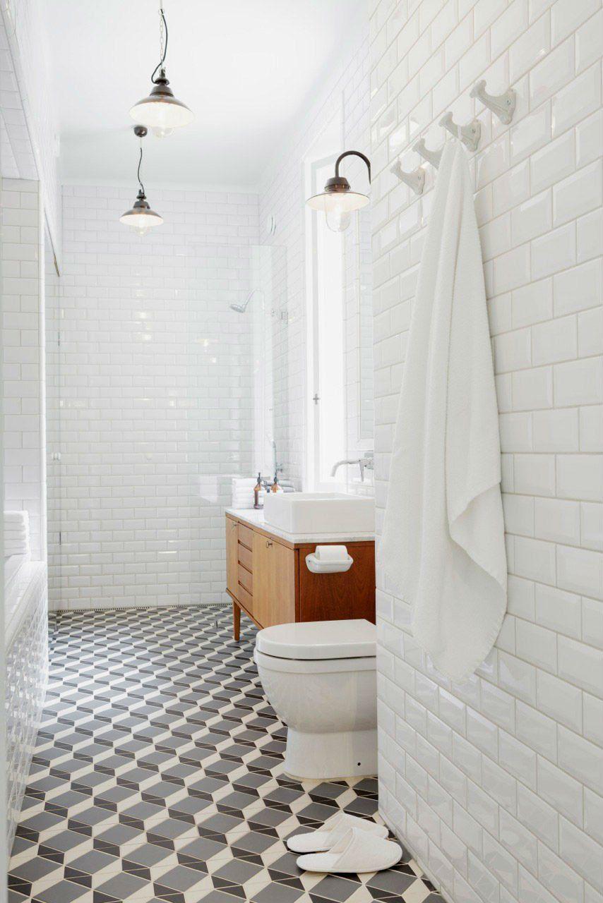 White Bathroom With Midcentury Modern Vanity And Beautiful Pattern Tile Floor